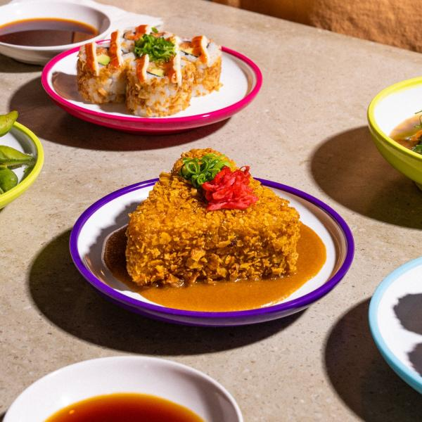 Table full of colourful sushi dishes